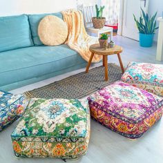 Add a bohemian vibe or an eclectic edge to your living areas! These floor pillows are perfect in bedrooms, living rooms, or children's play areas, providing a creative, useful, and luxurious accent to any space,  #bohemiandecor #bohostyle #floorcushion #pouf Mandala Towel, Living Rooms, Living Room Decor, Play Areas, Diy Flooring, Diy Pillows, Floor Cushions, Bohemian Decor, Vintage Rugs