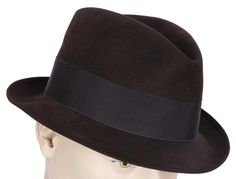 "This is a fine quality mens fedora hat made by Borsalino of Italy. The color is a very attractive deep eggplant brown, quite unusual. The hat is gold stamped on the upper interior silk lining with ""Cl"