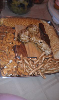 Homemade penis cheese ball with crackers and pretzels.