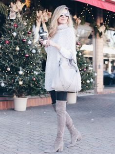 gray knit poncho and leather leggings with taupe over the knee suede boots