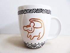 This coffee mug is inspired by the Disney movie The Lion King. The front of the mug is painted with the tree drawing of Simba from the movie,