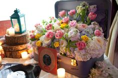guest book table with vintage suitcase filled with flowers. #flowers #wedding #suitcase #vintage