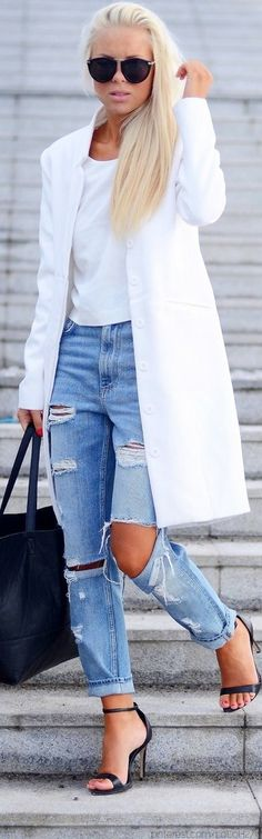 Ripped jeans & white coat.