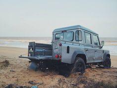 Land Rover Defender got stuck on the beach.
