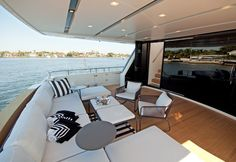 "Sanlorenzo SL104 Super Yacht ~ The aft deck was designed to be a ""put your feet up"" area for cocktails, après dinner, or breakfast coffee.  Basket woven modular furniture in graphic shades of smoke with ample white cushions. Also a generous supply of air conditioning."