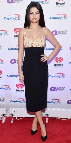 Selena Gomez struck a pose at the Jingle Ball Tour in a nude-and-black crystal-embroidered David Koma pencil dress with black satin pumps.
