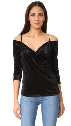¡Cómpralo ya!. St Olcay Gulsen Velvet Top - Black. A striped velvet ST Olcay Gulsen off shoulder top styled with a crossover neckline. Long sleeves and mesh lining. Fabric: Velvet. 95% polyester/5% elastane. Wash cold. Imported, China. Measurements Length: 20in / 51cm, from center back Measurements from size S. Available sizes: S , tophombrosdescubiertos, sinhombros, offshoulders, offtheshoulder, coldshoulder, off-the-shouldertop, schulterfreiestop, tophombrosdescubiertos, topdosnu…