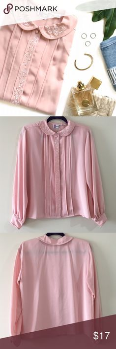 """Blush Embroidered Peter Pan Collar Blouse Comes in pink blush and features a peter pan collar and floral embroidery with pearl embellishments. Brand tag has been cut in half but I believe it was """"Prophesy"""". Size tag is 6 but can fit a Small or Medium. Has 6 regular buttons down the middle and one snap button at the very top. Semi-sheer. Has shoulder pads. One small stain near sleeve cuff (seen in 4th picture). 100% polyester Length: 23"""" Bust: 39"""" Sleeve Length: 22.5"""" Vintage Tops Blouses"""