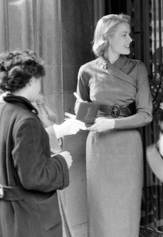 Grace Kelly with fans outside her New York Apartment