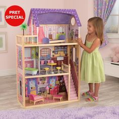 The KidKraft Kayla wooden dollhouse comes with a range of dollhouse furniture included in the price and the design will inspire any girls who love dolls. Wooden Dollhouse, Dollhouse Furniture, Bratz Doll, Barbie Dolls, Grande Lampe, Four Rooms, Live In Style, Hand Painted Furniture, Barbie House