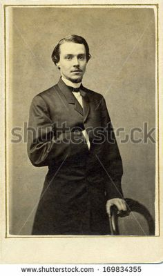 CIRCA 1863 - A vintage Cartes de visite photo of a young gentleman. The man is standing with one arm inserted into his coat. A photo from the Civil War era. A digital copy can be purchased at the above web link.