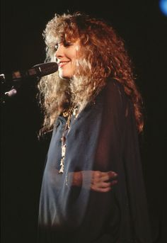 beautiful Stevie onstage, hugging herself within her sheer black chiffon shawl ☆♥❤♥☆
