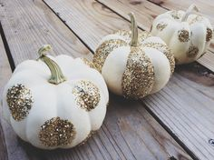 gold glitter on white mini pumpkins