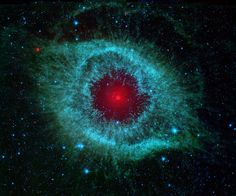 ~~Dust and the Helix Nebula ~ Dust makes this cosmic eye look red. The eerie Spitzer Space Telescope image shows infrared radiation from the well-studied Helix Nebula (NGC a mere 700 light-years away in the constellation Aquarius Helix Nebula, Planetary Nebula, Orion Nebula, Andromeda Galaxy, Eagle Nebula, Planetary System, Cosmos, Space Photos, Space Images