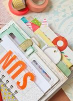 Really cute mini album using frames, envelopes, and bind it all