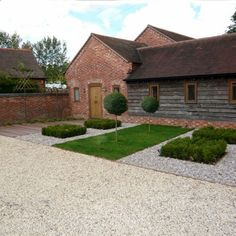 Timber clad link  Minimal barn conversion garden by henley on thames garden designer jo