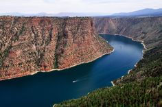 13 incredible Utah adventures you've probably never heard of In 1964 the Flaming Gorge Dam was built, creating a 91-mile-long lake in northeast Utah. It is between Yellowstone & Arches National Parks & can go kayaking, canoeing, & exploring 350 miles of shoreline. water-accessible campgrounds Sheep Creek is the best boat launch, as it's closest to the most scenic areas: Flaming Gorge, Horseshoe Canyon, Hideout Draw, and Red Canyon. from Matador Network