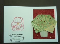 Handfolded origami tree card showing detail on rear of card.