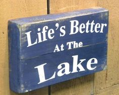 "This rustic wooden pallet sign reads """"Life's Better at the Lake."""" A great piece of wall decor to spruce up your lake house or a perfect rustic decor item for anyone that loves the outdoors! Made fro"
