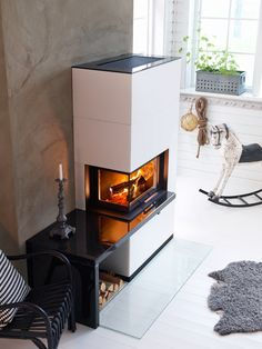 The Contura i41A fireplace has an angled door and is clad in artstone