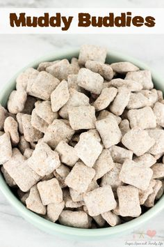 Muddy Buddies aka puppy chow are a delicious kid friendly treat or sweet snack. Kids will love these rice cereal squares covered in melted chocolate and peanut butter, and tossed in powdered sugar. - Muddy Buddies Recipe from Sugar, Spice and Family Life