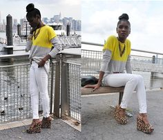 Vintage fashion blogger Jessica Virgin loves adding bright colors to her fall wardrobe with this neon colorblock sweater. She combined it with a classic brown belt, white skinny jeans and leopard wedges to give a simple outfit some bite.      Hype Jessica's look: http://lookbook.nu/look/3977418-NEON-by-the-DOCKS