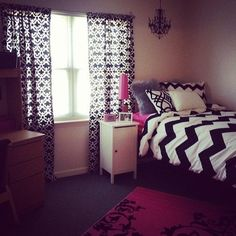 Black and white college dorm room with pink accents and chevron bedding