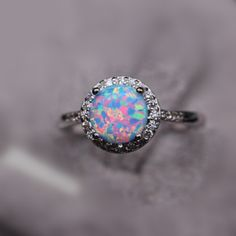 Blue and pink opal ring
