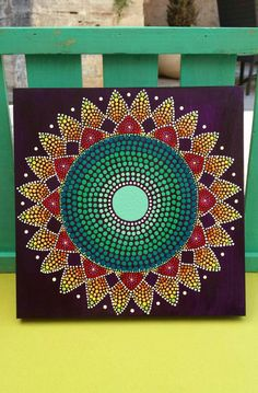 Hand painted mandala on wooden board