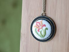 Cross stitch pendant necklace - Iris Flower - Orange with Antique Brass Setting, 38 mm (1.5inch) Round