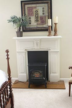 Make a faux fireplace/wood stove setup using an electric heater. I like the idea... can't show the cord though it takes away from it.