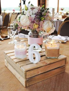 Example of a centre piece on one of the wedding breakfast tables... We love the idea of the number 6!