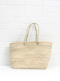 c1c17be82f1 A bohemian style contemporary tote basket handmade in Morocco. Natural palm  leaf shoulder bag perfect