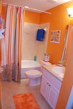 What Do You Think Of This Daring Orange Bathroom Highland Homes Model Home In