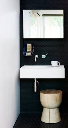 Cool use of black penny round tiles!                                                                                                                                                                                 More