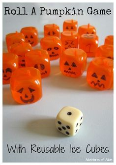 Roll A Pumpkin Game with Reusable Ice Cubes.  Draw pumpkin faces on orange reusable plastic ice cubes to create a Halloween inspired number game.