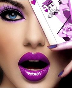 Amazing and bold! Purple eye shadow and lipstick.