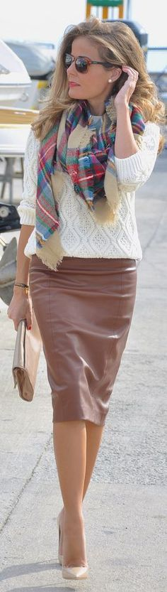 Brown leather skirt, chunky ivory sweater and plaid scarf. Simple and chic outfit idea.