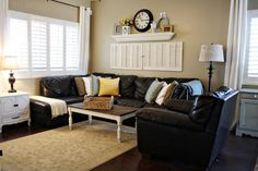 I love the shutters & shelf above the sectional.... from Clarendon Lane - my fav blog!