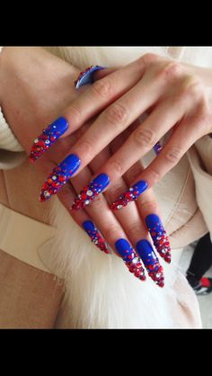 Blue nails with red swarovski crystals