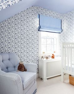 Home Tour: Celerie Kemble Designs a Stylish Yet Versatile Family Home—For a baby's room, Kemble chose blue-and-white animal wallpaper in a clean navy.