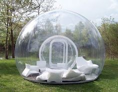 Inflatable lawn tent. Imagine laying in this when it's raining or snowing. I WANT.