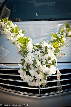 Floral decoration on brides car..