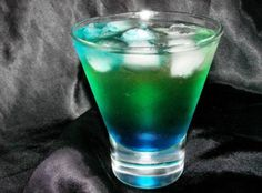 Seahawk cocktail-  ice, 30 ml banana liqueur  30 ml Midori melon liqueur  30 ml peach liqueur  30 ml malibu coconut rum  30 ml blue curacao  soda water, to top  Half fill a cocktail shaker with ice.  Add all ingredients except for the caracao & soda water.  Shake & strain into a highball (tall) glass. top with soda water, leaving enough room to float the blue caracao on top.