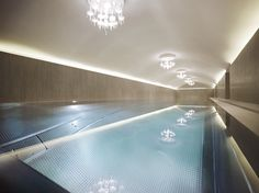 24 Hotels With Spectacular Indoor Pools Inspired by the ancient Roman baths, indoor swimming pools have become common hotel features, social hubs and even architectural wonders. Spa Hotel, Hotel Pool, Pool Spa, Indoor Pools, Vienna Hotel, Luxury Swimming Pools, Wallpaper Magazine, Best Hotel Deals, Travel Wallpaper