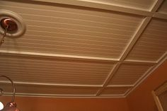 Painted beadboard with 1X2 boards to disguise ugly drop ceiling