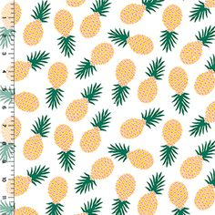 Tossed Pineapples on White Cotton Jersey Blend Knit Fabric $6.50/yd