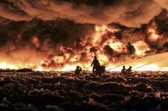Recycled ruins:  West Midland firefighters tackle a large blaze at a recycling plant in central England on July 1, 2013. More than 150 firefighters worked to control the blaze involving 100,000 tons of plastic recycling material that sent a plume of smoke rising 6,000 feet into the air.