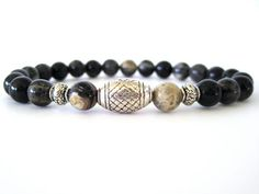 Cool men's beaded stretch bracelet featuring 8mm black silver leaf beads and pewter accent beads. A very masculine men's bracelet any man would love! Wear individually or stack with leather wraps, a watch or other Rock & Hardware men's bracelets for a more stylish option.
