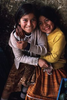 Girls Playing in the Market, Ambato, Ecuador (1980) by philipbouchard #portraits #tailoredforeducation